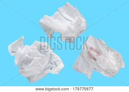 Piece paper tissue white isolated on blue background with clipping path.