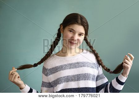 Teen Girl With Plaited Long Brown Hair Braids