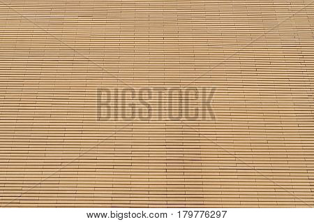 Brick wall beige color high-rise building as a background
