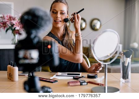 Young Female Vlogger Recording A Make-up Broadcast.