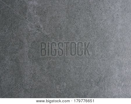 Gray granite stone background from top view