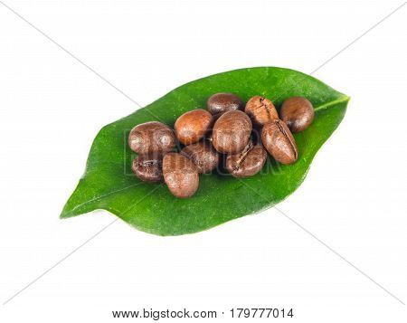 Coffee grains on green leaf over isolated white background