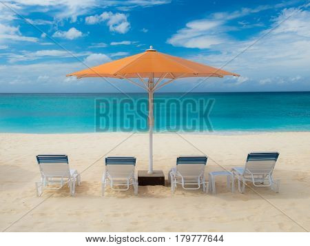 parasol and sun loungers on Seven Mile Beach,Cayman Islands