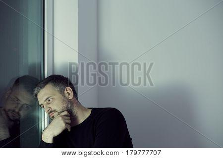Man Looking Through The Window