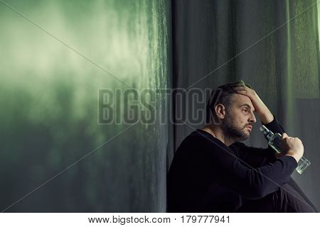 Alcoholic Drinking From A Bottle
