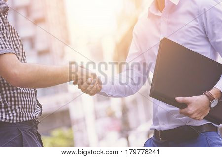 Businessmen shaking hands, Business success Deals or Mergers and acquisitions and corporate restructuring concept