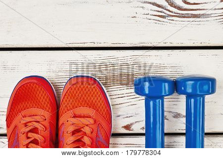 Women's sneakers and dumbbells. Time to get healthier.