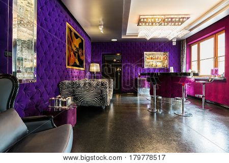 Modern Apartment With Upholstered Violet Walls