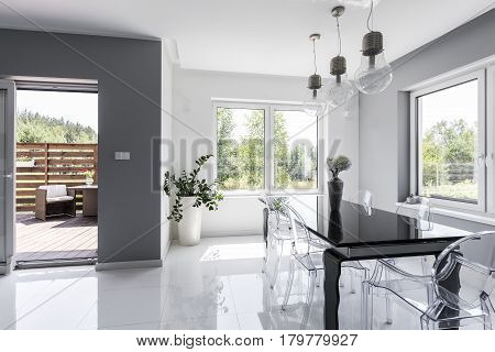 Bright Dining Room With A Black Table