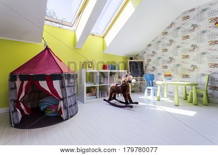 Kids Room With Play Tent And A Rocking Horse