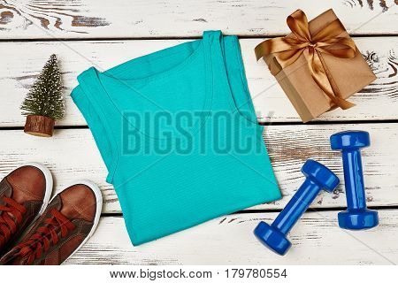 Tank top, dumbbells and footwear. Present for sportsman.