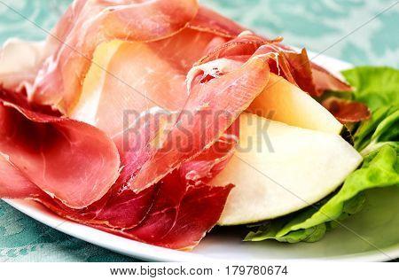 Traditional Italian antipasti. Ham melon on the plate