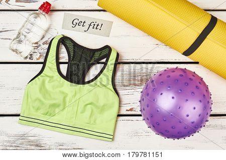 Tank top and ball. Enjoy active life.