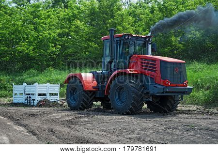 The competition of tractors for overtaking cargo in 10 tons. Rostov-on-Don, Russia, June 4, 2016
