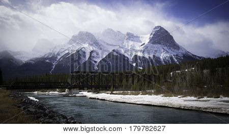 Three sisters, Bow River, mountain view of the 3 Sisters, Canmore Engine Bridgea