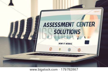 Assessment Center Solutions on Landing Page of Laptop Screen. Closeup View. Modern Meeting Room Background. Blurred Image with Selective focus. 3D.
