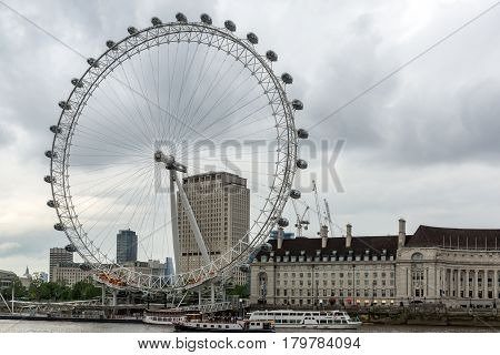 LONDON, ENGLAND - JUNE 16 2016: The London Eye and County Hall from Westminster bridge, London, England, Great Britain
