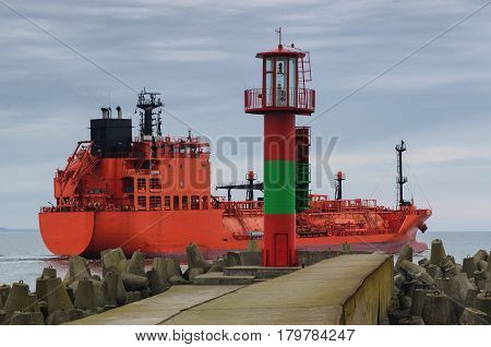 RED LPG TANKER - The red ship sails into the sea