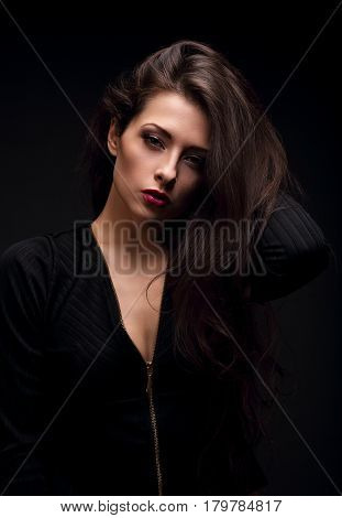 Beautiful Glamour Female Model With Long Hair Posing In Black Shirt On Dark Black Background With Re