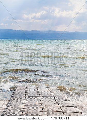 Pontoon Pier On Coast Of Dead Sea In Winter