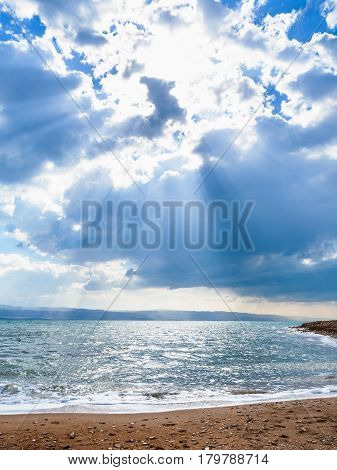 Sunlight Passes Through Blue Clouds Over Dead Sea