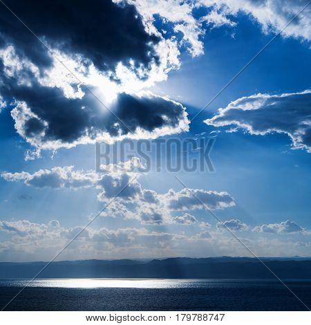 Sunlight Passes Through Dark Clouds Over Dead Sea