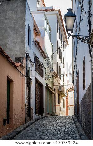 Icod de los Vinos old town narrow street vertical photo. Tenerife island, Canaries, Spain.