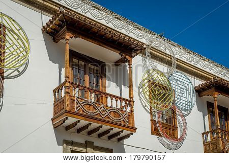 Traditional Canary islands wooden balcony in the center of Icod de los Vinos. Tenerife, Spain.