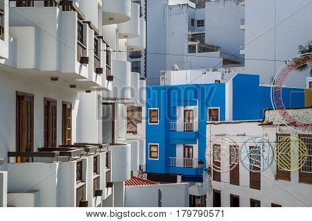 Icod de los Vinos old town houses and balconies in weird composition. Tenerife, Canary islands, Spain