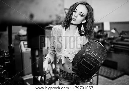 Red Haired Girl Wear On Short Denim Shorts And White Blouse With Welding Mask At Hands Posed At Indu