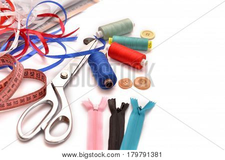 Set of different sewing accessoriesfabrics and thread spools