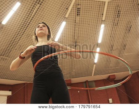 Teenager Girl With Hula Hoop In Gym