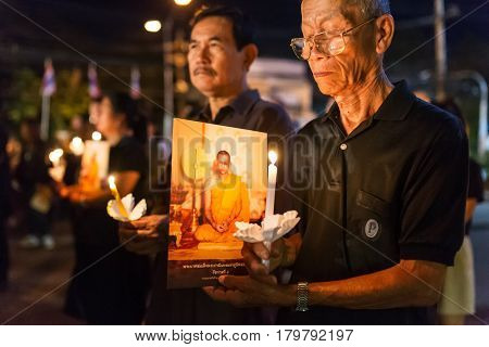 Chiang mai - December 5, 2017: Thai people lighting candles and pray in memory of His Majesty the King of Thailand