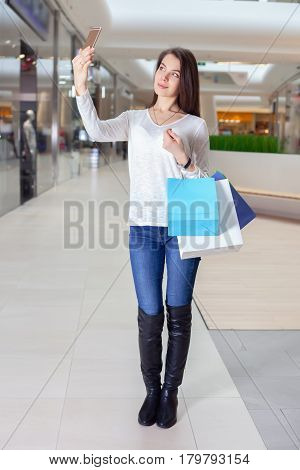 Beautiful Girl Makes Selfie In A Shopping Centre