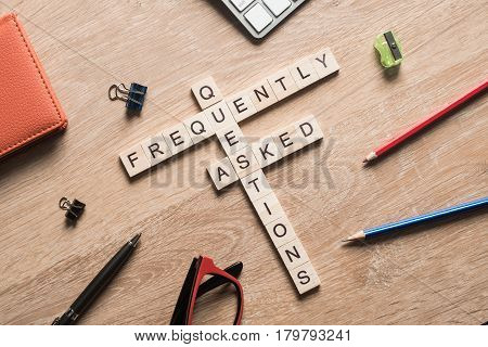 Croosword made of game cubes presenting feedback and faq