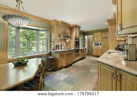 Kitchen in contemporary home with oak wood cabinetry.