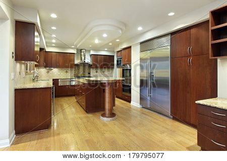 Kitchen in luxury home with double decker island.