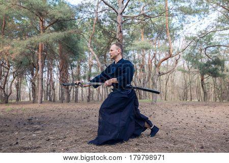 Caucasian Man With A Japanese Sword, A Katana Practicing Iaido