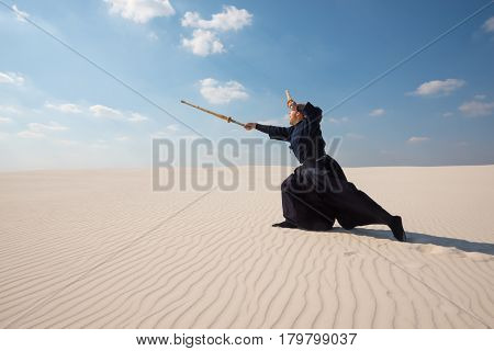 Man Is Making A Powerful Lunge With A Bamboo Sword