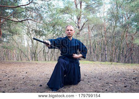 Man With A Japanese Sword, A Katana Practicing Iaido