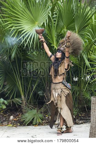 Tulum, Mexico, March 15th, 2017: Woman in Maya indian costume in Tulum, Mexico