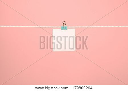 Blank Pink Paper Note On Clothesline
