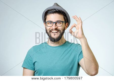 Happy Young Man Gesturing Ok Sign