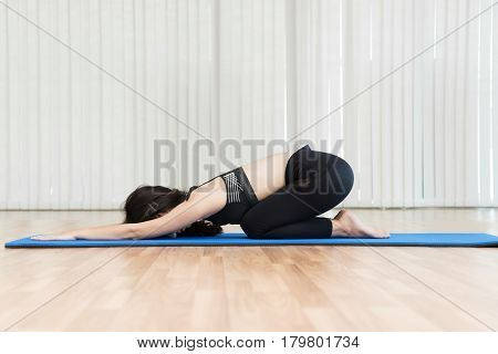 Young Asian woman in plank position of yoga. Copy space.