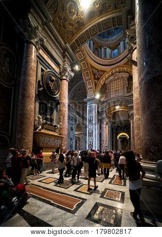 ROME, ITALY - MAY 12, 2014: Interior of Saint Peter's Basilica. St. Peter's Basilica (San Pietro) is one of the main tourist attractions of Rome and Vatican.