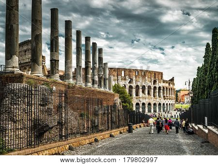 ROME, ITALY - MAY 10, 2014: View of the Colosseum (Coliseum) from the Roman Forum.