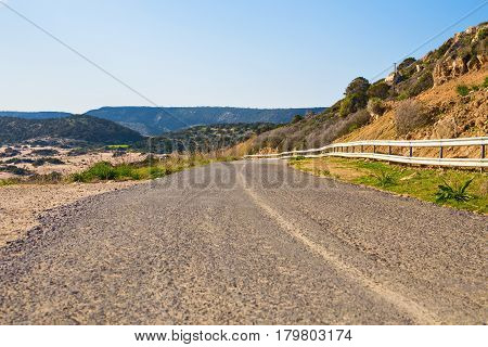 highway beside the sea. sea side street near the mountain with blue sky in clear day