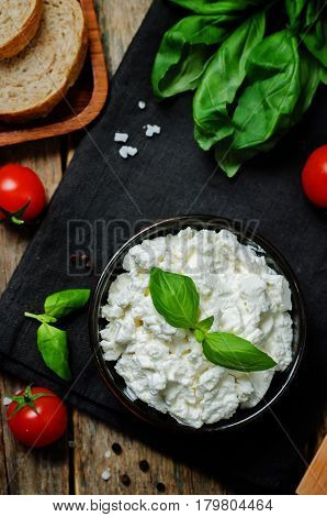 healthy and natural ricotta cheese on a wood background