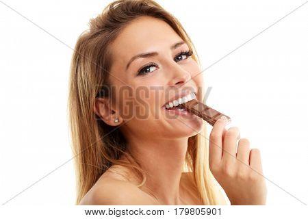 Portrait of beautiful woman holding chocolate bar