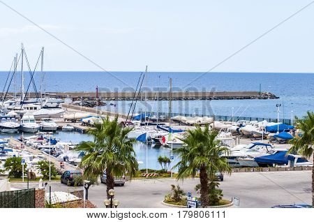 yacht boat and Fishing boats in a harbor on sardegna island in italy